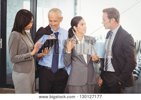 Businesspeople interacting and working in office