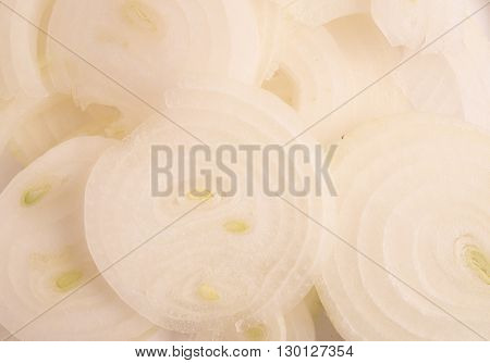 slice white onions as background close up view