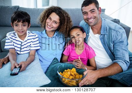 Portrait of family watching match together in living room