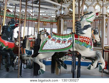 BROOKLYN, NEW YORK - MAY 14, 2016: Horses on a traditional fairground B&B carousel at historic Coney Island Boardwalk in Brooklyn
