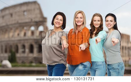 choice, friendship, travel, tourism and people concept - group of happy plus size women in casual clothes pointing finger on you over rome coliseum background