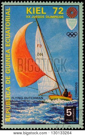 MOSCOW RUSSIA - MAY 17 2016: A stamp printed in Equatorial Guinea shows yachting the race in Flying Dutchman class series