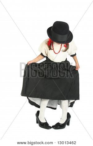 Little girl in mother's shoes and black-and-white clothes
