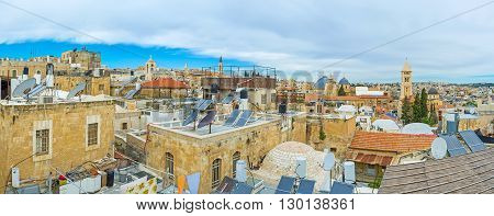 The medieval roofs of the stone houses in Armenian Quarter with the numerous satellites and solar panels Jerusalem Israel.
