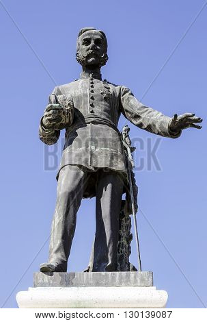 Aranjuez Spain - March 13 2016: In Aranjuez the first statue to the King of Spain. D. Alfonso XII. Situated on a base of stone doors Market of Aranjuez in Madrid