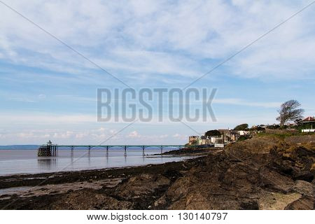 View Over Rocks At Clevedon Sea Front, Including Pier In Background.