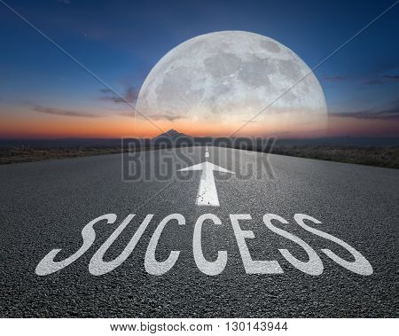Driving on an empty imaginative road towards the big fantasy moon with sign success on asphalt as text. Concept for success and passing time.