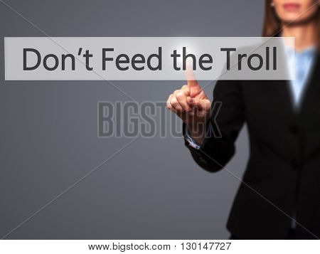 Don't Feed The Troll - Businesswoman Hand Pressing Button On Touch Screen Interface.
