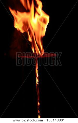 Fire flame abstract. Burning log closeup on dark background