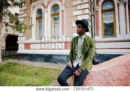 Close Up Fashion Portrait Of Black African American Man On Green Velvet Jacket And Black Hat Sit On