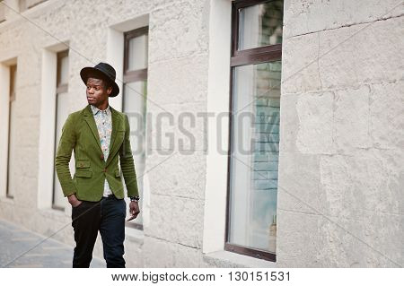 Fashion Portrait Of Black African American Man On Green Velvet Jacket And Black Hat Walking On Stree
