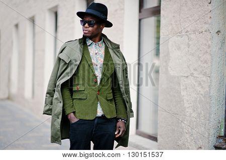 Fashion Portrait Of Black African American Man On Green Velvet Jacket, Black Hat And Coat Cloak On H
