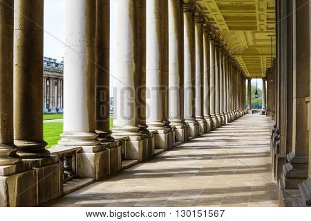 Colonnade and shadow in Old Royal Naval College University of Greenwich London.