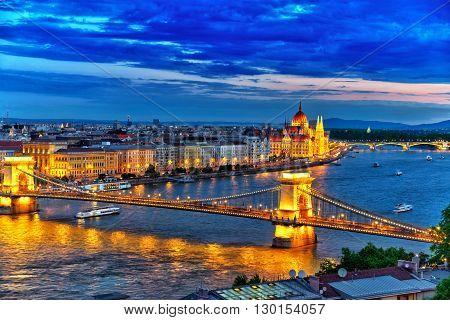 Szechenyi Chain Bridge And Parliament At Dusk. Budapest, Hungary.