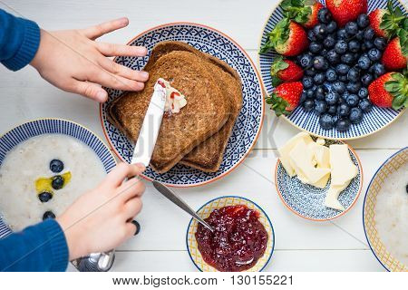 Tasty Family Breakfast With Toasts, Porridge, Berries