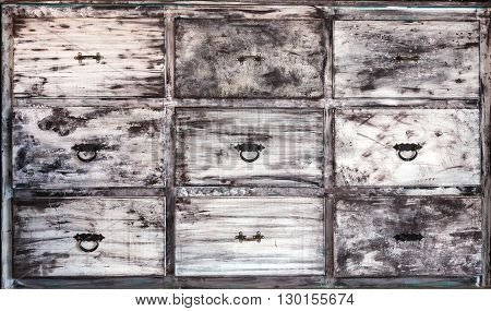 This is vintage white painted wooden drawers.