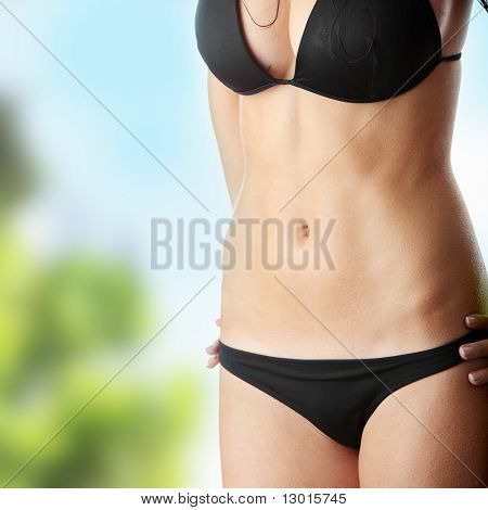 Beautiful wet caucasian woman in black bikini
