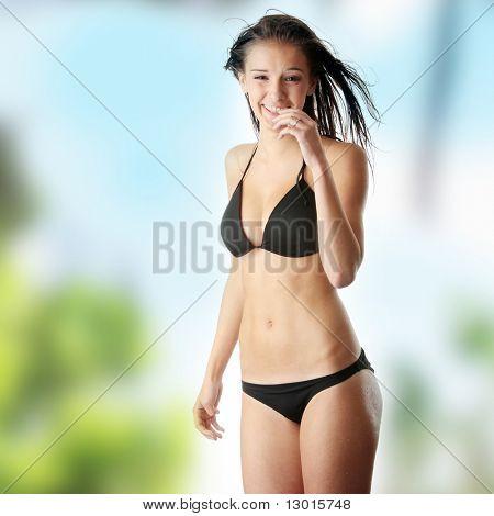 Beautiful wet caucasian woman in black bikini