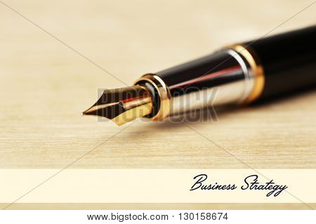 Fountain pen on wooden table background