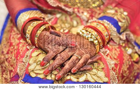 Bridal henna covered hands of an Indian Bride