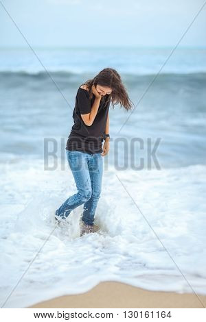 happy beautiful woman enjoying the waves on the tropical sea. Beach fun
