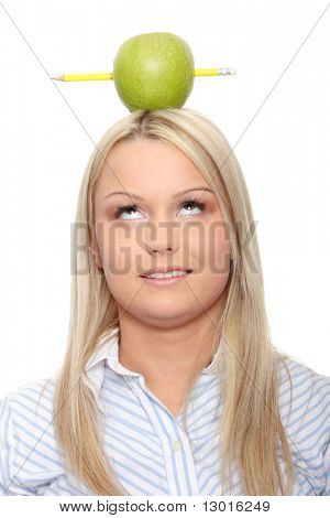 Beautiful student woman have one apple with pencil on her head - learning concept
