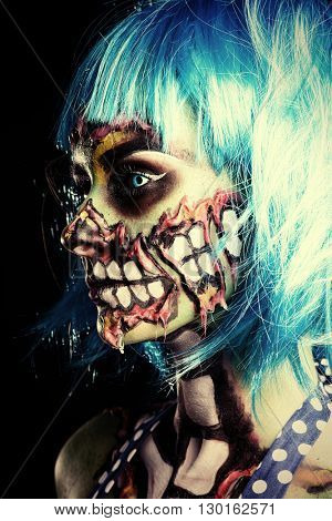Fashionable zombie girl. Portrait of a pin-up zombie woman. Body-painting project. Halloween make-up. Horror.