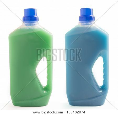 Two plastic bottles of cleaning liquid isolated on white background