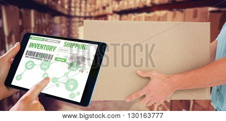Man using tablet pc against boxes in warehouse