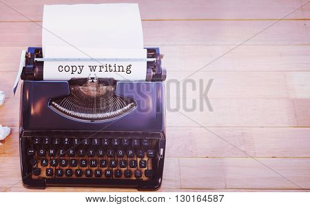 Copy writing message on a white background against typewriter with paper on table in office