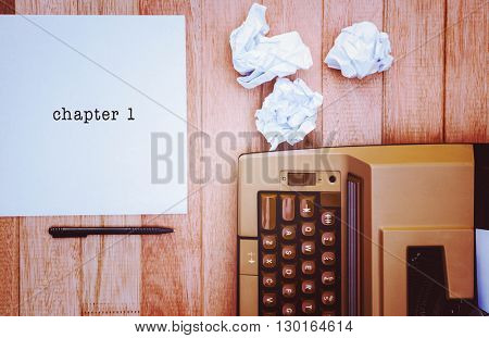 Chapter 1 message on a white background against view of an old typewriter and paper