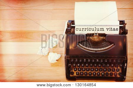 Curriculum vitae message on a white background against typewriter with paper on table in office