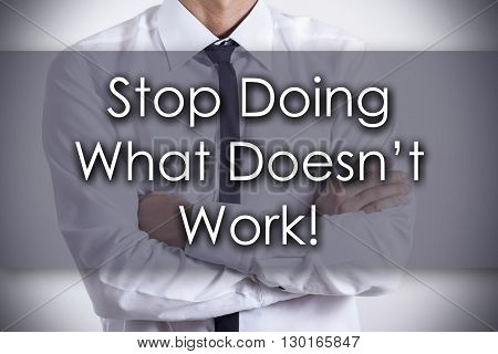 Stop Doing What Doesn't Work! - Young Businessman With Text - Business Concept