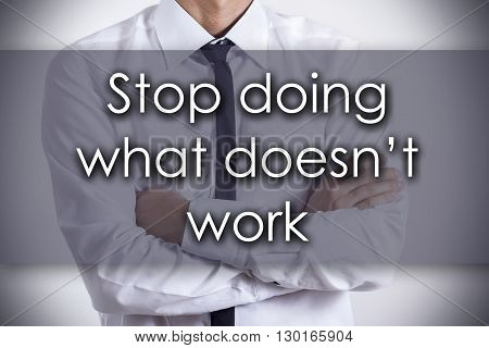 Stop Doing What Doesn't Work - Young Businessman With Text - Business Concept