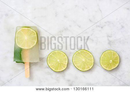 Fresh summer lime popsicles on white marble