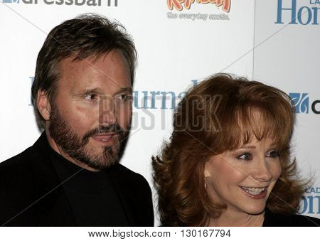 Reba McEntire and Narvel Blackstock at the 2005 'Funny Ladies We Love' Awards Hosted by Ladies' Home Journal held at the Pearl in West Hollywood, USA on February 2, 2005.