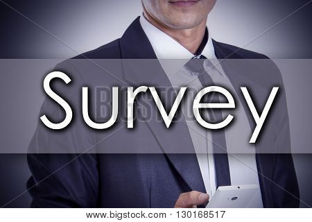 Survey - Young Businessman With Text - Business Concept