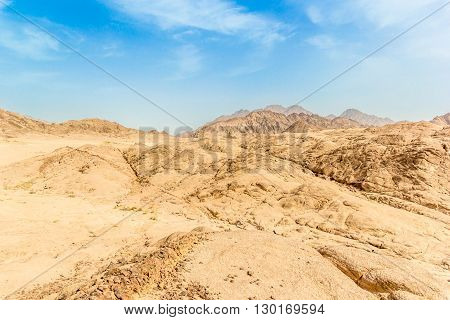 Photo with african mountain desert under blue sky