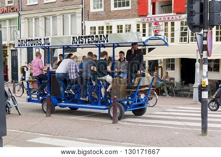 Amsterdam, Netherlands - May 4: This is a special bike tour through the city with the opportunity to ride a special cycling machine and drink beer May 4, 2013 in Amsterdam, Netherlands.