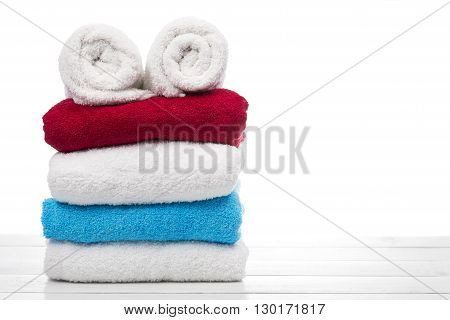 stack of towels on a white table