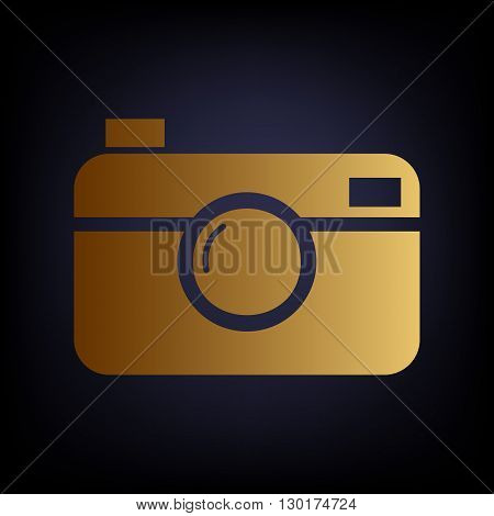 Digital photo camera icon. Golden style icon on dark blue background.