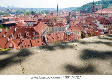 blurred view from above of the houses with red-tiled roofs Prague Czech Republic