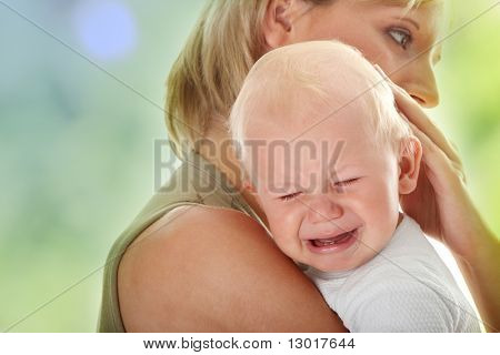 Mother holding her crying baby