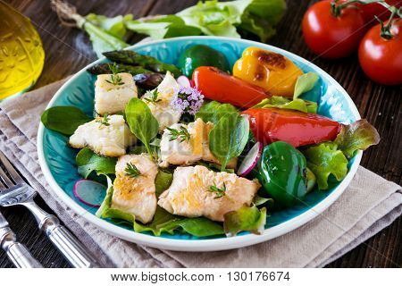 Fish Fillets With Vegetables On Wooden Background