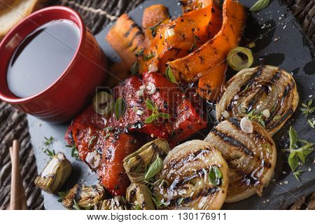 Grilled seasonal vegetables dressed with herbs balsamic winegar and olive oil