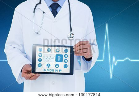 A doctor showing digital tablet against electrocardiogram