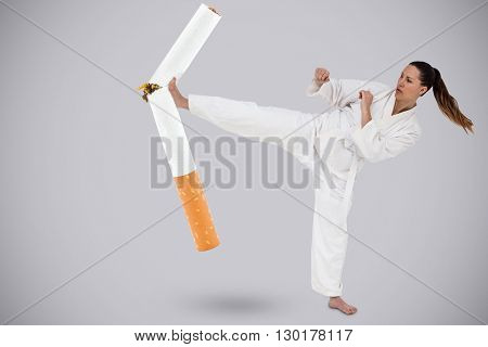 Fighter performing karate stance against light grey