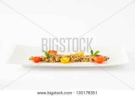 Quinoa, tomatoes and spinach isolated on white background