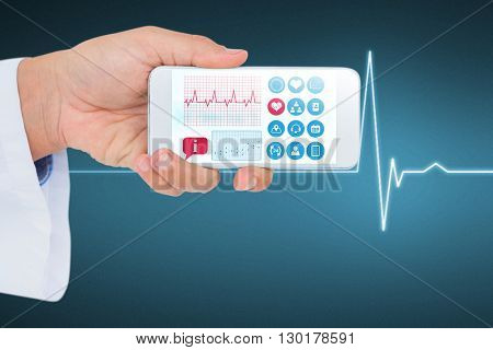 Male doctor holding smart phone with blank screen against electrocardiogram