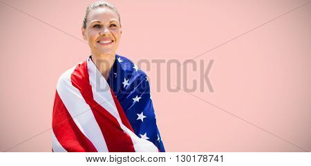 Portrait of american sportswoman is smiling against light pink